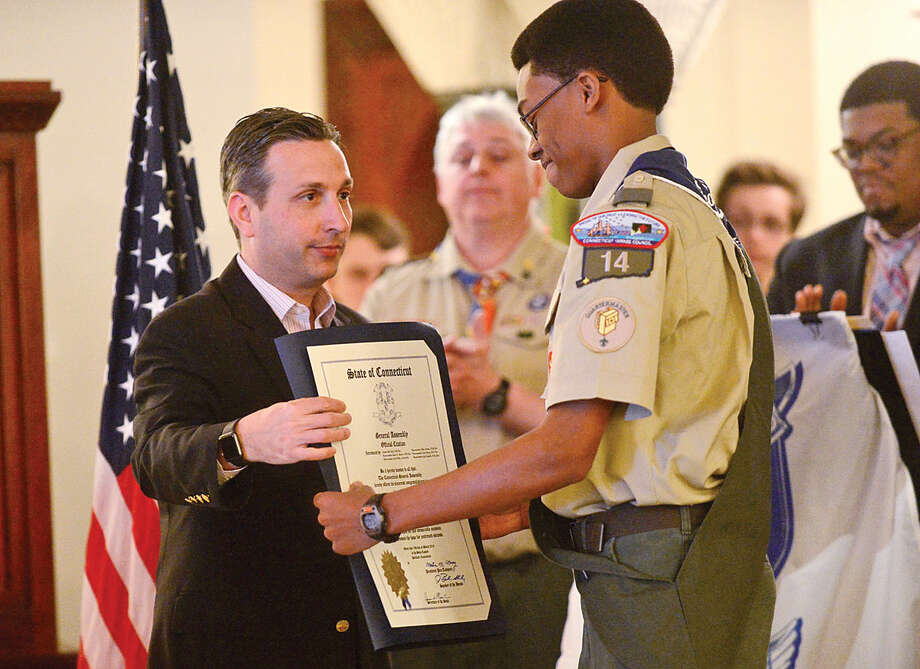 Hour photo / Erik Trautmann Sean Walters is honored during the Boy Scout Eagle Court of Honor ceremony at St. George Greek Orthodox Church where Walters was awarded the Eagle Scout Badge with the help of his family and dignitaries including State Senate Majority Leader Bob Duff Saturday afternoon.
