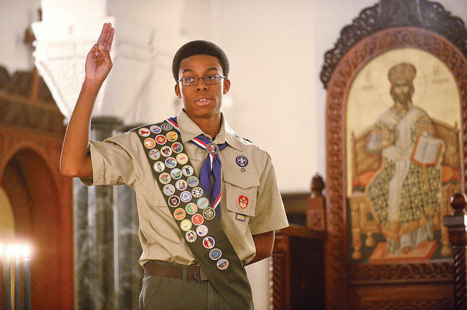 Hour photo / Erik Trautmann Sean Walters is honored during the Boy Scout Eagle Court of Honor ceremony at St. George Greek Orthodox Church where Walters was awarded the Eagle Scout Badge with the help of his family and dignitaries Saturday afternoon.