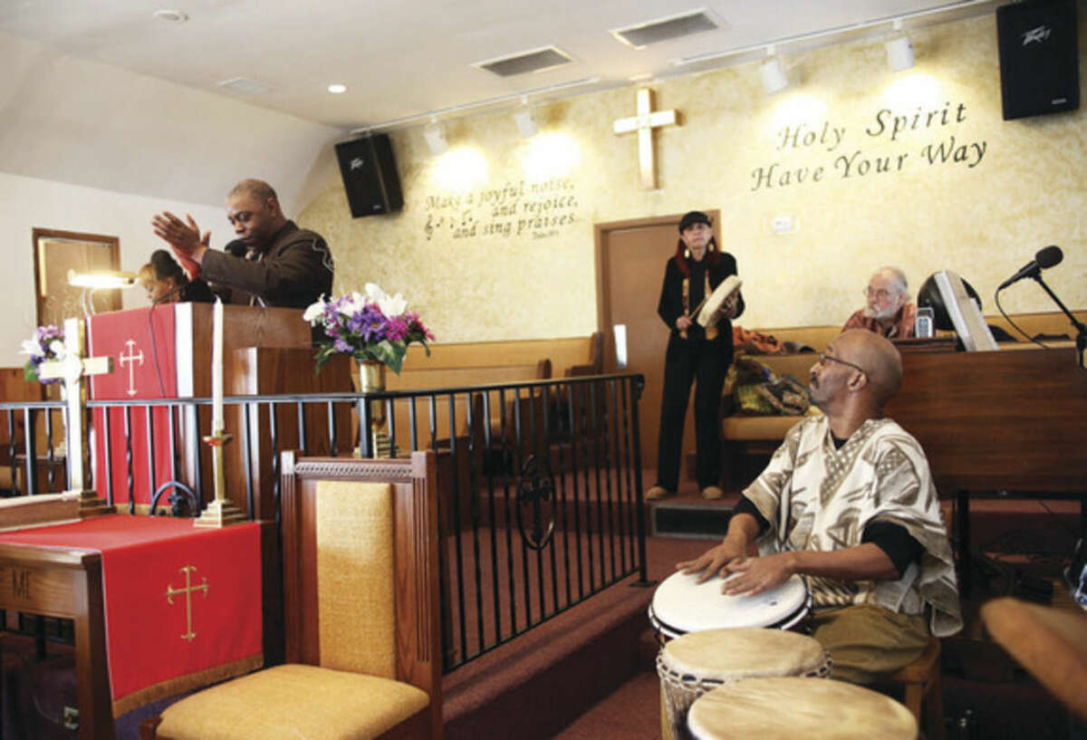 The Reverend DuBose and members of Drums Not Guns perform during St. James Church's Black History event Sunday afternoon. Hour Photo / Danielle Calloway