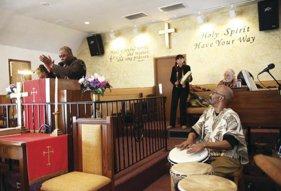 The Reverend DuBose and members of Drums Not Guns perform during St. James Church's Black History event Sunday afternoon.Hour Photo / Danielle Calloway