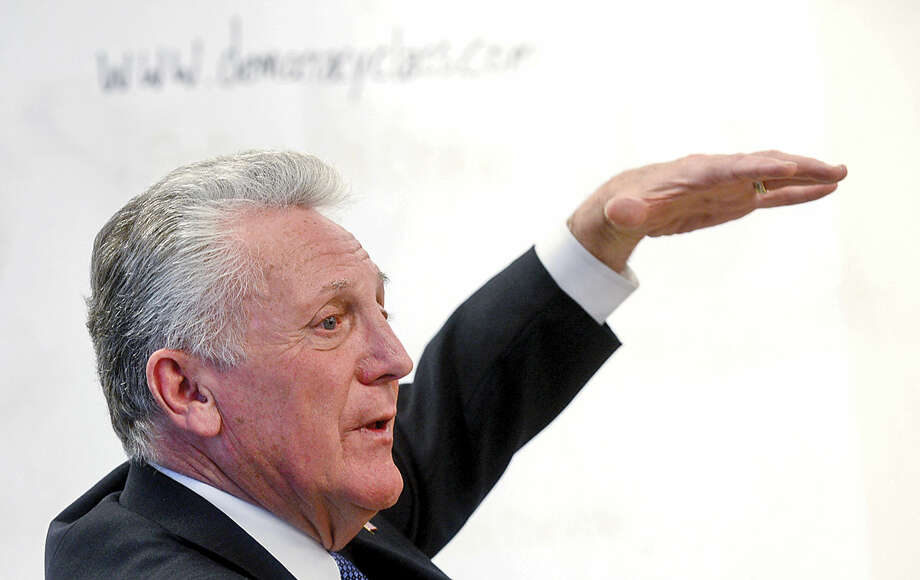 Hour photo / Erik Trautmann Norwalk Mayor Harry Rilling teaches the importance of voting during Tom Keyes' civics class at the mayor's alma mater, Norwalk High School, Wednesday morning.