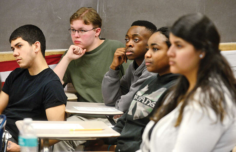 Hour photo / Erik Trautmann Students listen as Norwalk Mayor Harry Rilling teaches the importance of voting during Tom Keyes' civics class at the mayor's alma mater, Norwalk High School, Wednesday morning.