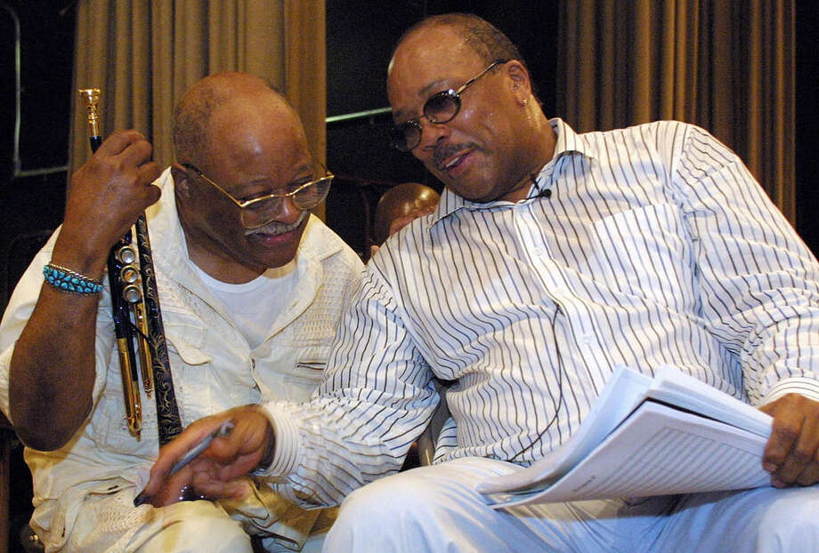 "File-This June 13, 2001, file photo shows Quincy Jones, right, talking with jazz musician Clark Terry at a rehearsal of ""Sonic Convergence,"" in New York. Terry, a legendary jazz trumpeter, who mentored Miles Davis and Jones and played in the orchestras of both Count Basie and Duke Ellington and on ""The Tonight Show,"" has died. He was 94. (AP Photo/Stuart Ramson, File)"