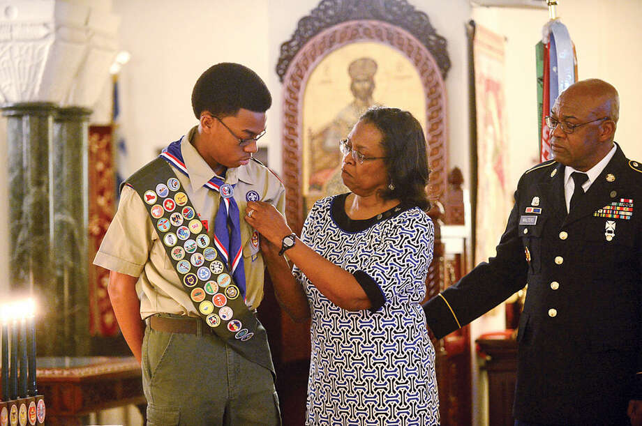 Hour photo / Erik Trautmann Sean Walters is honored during the Boy Scout Eagle Court of Honor ceremony at St. George Greek Orthodox Church where Walters was awarded the Eagle Scout Badge with the help of his family including his mother Dee Walters, father Greg Walters and other dignitaries Saturday afternoon.