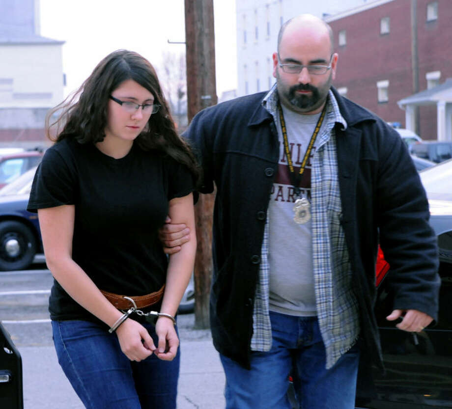 FILE - In this Tuesday, Dec. 3, 2013 file photo, Miranda K. Barbour is led into District Judge Ben Apfelbaum's office in Sunbury, Pa., by Sunbury policeman Travis Bremigen. In an interview with The Daily Item newspaper published Feb. 15, 2014, Barbour, charged along with her newlywed husband Elytte Barbour in the murder of a man they met through Craigslist, admitted to the slaying and said she has killed more than 20 others across the country, claims police said they are investigating. (AP Photo/The News-Item, Mike Staugaitis, File) MANDATORY CREDIT