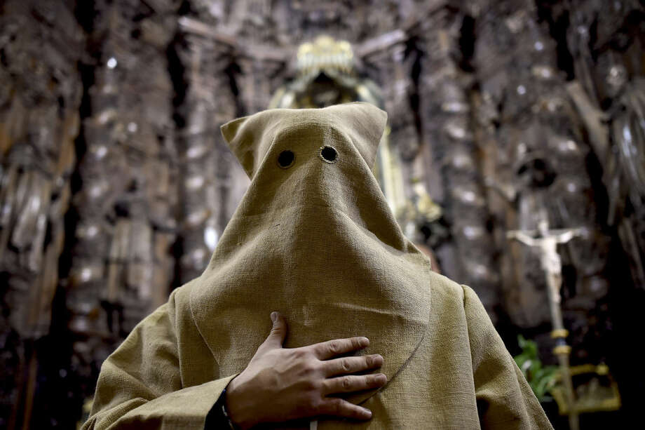 "An 'Ensacado,'' or masked penitent, takes part in the procession of the ""Silencio del Santisimo Cristo del Rebate"" brotherhood, during Holy Week in Tarazona, northern Spain, Tuesday, March 22, 2016. Hundreds of processions take place throughout Spain during the Easter Holy Week. (AP Photo/Alvaro Barrientos)"