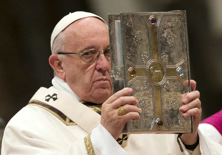 Pope Francis holds the Gospel book as he leads a Chrism Mass in St. Peter's Basilica at the Vatican Thursday, March 24, 2016. During the Mass the Pontiff blesses a token amount of oil that will be used to administer the sacraments for the year. (AP Photo/Alessandra Tarantino)
