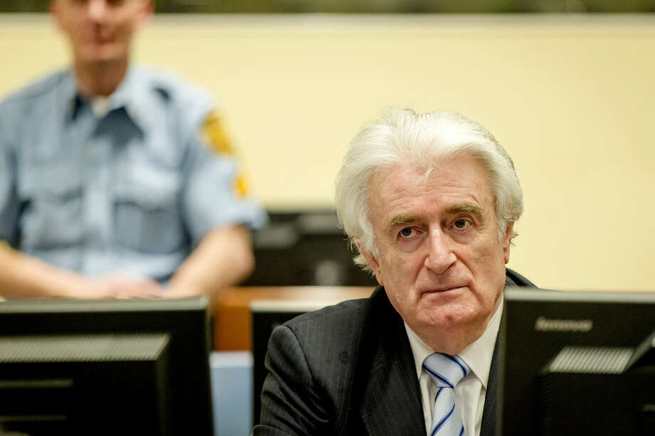 Bosnian Serb wartime leader Radovan Karadzic in the courtroom for the reading of his verdict at the International Criminal Tribunal for Former Yugoslavia (ICTY) in The Hague, The Netherlands Thursday March 24, 2016.The former Bosnian-Serbs leader is indicted for genocide, crimes against humanity, and war crimes. (Robin van Lonkhuijsen, Pool via AP)