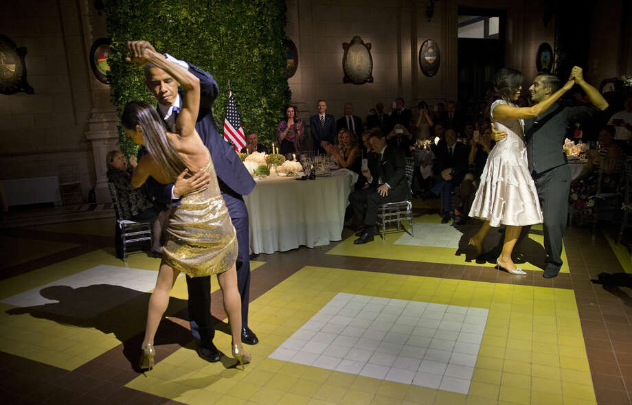 President Barack Obama and first lady Michelle Obama, right, dance the tango with tango dancers during the State Dinner at the Centro Cultural Kirchner, Wednesday, March 23, 2016, in Buenos Aires, Argentina. (AP Photo/Pablo Martinez Monsivais)