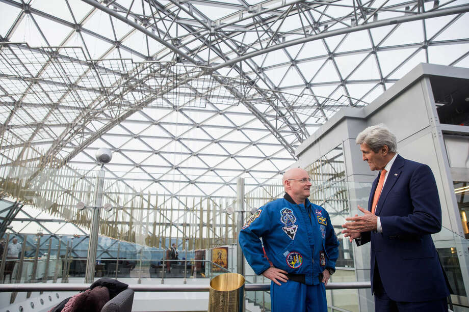 Secretary of State John Kerry meets with astronaut Scott Kelly at the Ritz-Carlton Hotel in Moscow, Russia, Thursday, March 24, 2016. Kerry is in Russia for talks on Ukraine and Syria as the terrorist attacks in Brussels underscored the urgency of fighting the Islamic State group. (AP Photo/Andrew Harnik, Pool)