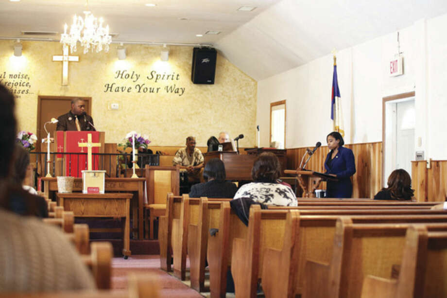 "Councilwoman Phaedrel ""Faye"" Bowman, reads the Black History Proclimation on behalf of Mayor Harry Rilling, during St. James Church's Black History event Sunday afternoon.Hour Photo / Danielle Calloway"