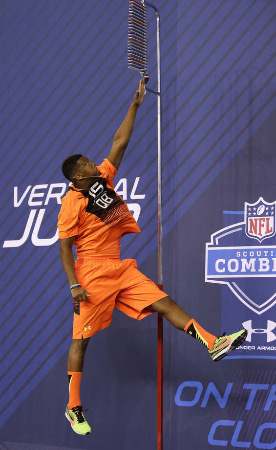 Florida State quarterback Jameis Winston leaps during the vertical jump drill at the NFL football scouting combine in Indianapolis, Saturday, Feb. 21, 2015. (AP Photo/David J. Phillip)