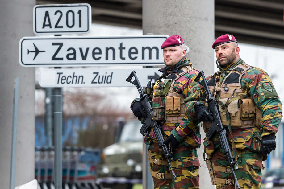 Belgian Army soldiers patrol at Zaventem Airport in Brussels on Wednesday, March 23, 2016. Belgian authorities were searching Wednesday for a top suspect in the country's deadliest attacks in decades, as the European Union's capital awoke under guard and with limited public transport after 34 were killed in bombings on the Brussels airport and a subway station. (AP Photo/Geert Vanden Wijngaert)
