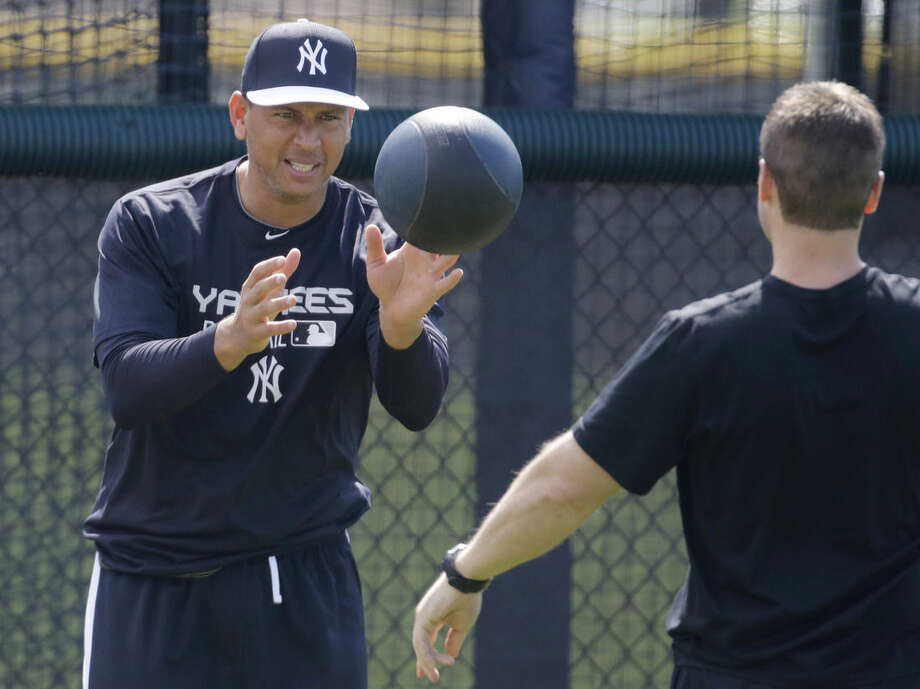 New York Yankees' Alex Rodriguez works out at the Yankees minor league facility before reporting for spring training baseball, Monday, Feb. 23, 2015, in Tampa, Fla. The official full squad workouts begin Feb. 26. (AP Photo/Chris O'Meara)