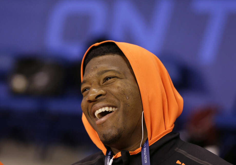 Florida State quarterback Jameis Winston smiles before stretching at the NFL football scouting combine in Indianapolis, Saturday, Feb. 21, 2015. (AP Photo/David J. Phillip)