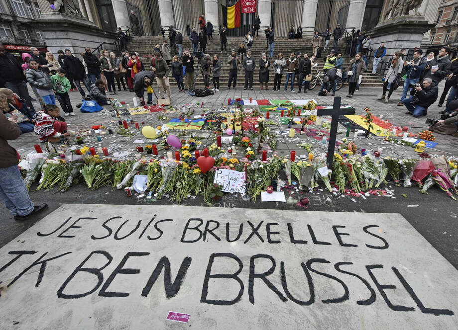 """A banner for the victims of the bombings reads """" I am Brussels"""" at the Place de la Bourse in the center of Brussels, Wednesday, March 23, 2016. Bombs exploded yesterday at the Brussels airport and one of the city's metro stations Tuesday, killing and wounding scores of people, as a European capital was again locked down amid heightened security threats. (AP Photo/Martin Meissner)"""