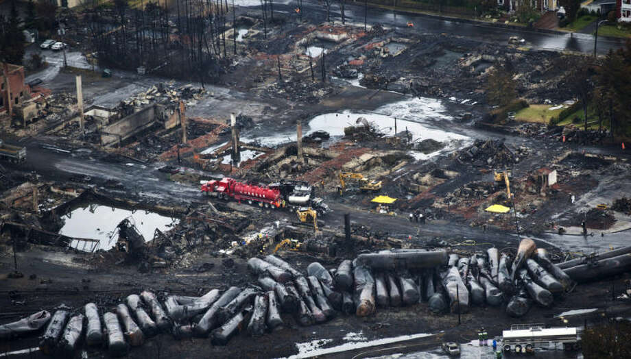 AP Photo/The Canadian Press, Paul Chiasson, FileIn this July 9, 2013, file photo, workers comb through debris after an oil train derailed and exploded in the town of Lac-Megantic, Quebec, killing 47 people. In response to Lac-Megantic, the National Transportation Safety Board and Transportation Safety Board of Canada in January 2014, called on regulators to require railroads to take stock of the risks along certain oil train routes and change them if needed.