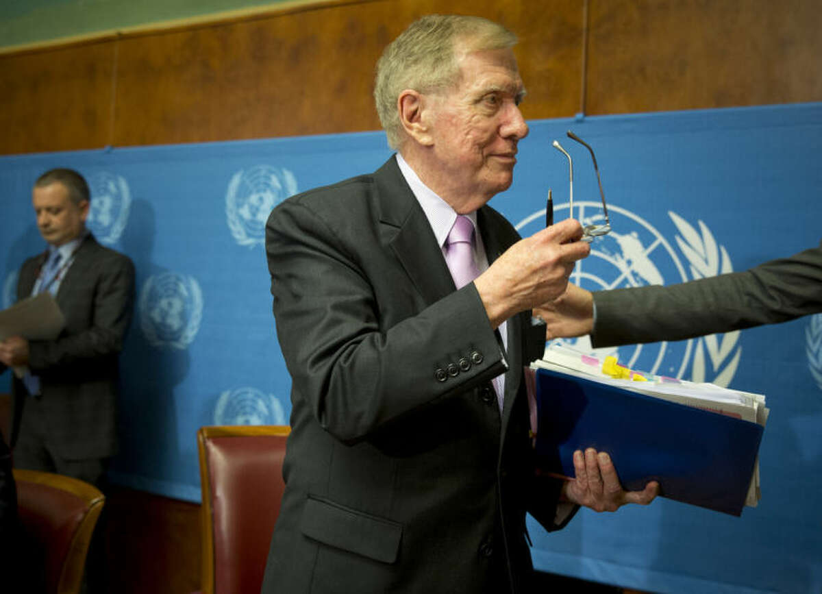 Retired Australian judge Michael Kirby, center, chairperson of the commission of Inquiry on Human Rights in the Democratic People's Republic of Korea, takes off his glasses after delivering the commission's report during a press conference at the United Nations in Geneva, Switzerland, Monday, Feb. 17, 2014. A U.N. panel has warned North Korean leader Kim Jong Un that he may be held accountable for orchestrating widespread crimes against civilians in the secretive Asian nation. Kirby told the leader in a letter accompanying a yearlong investigative report on North Korea that international prosecution is needed