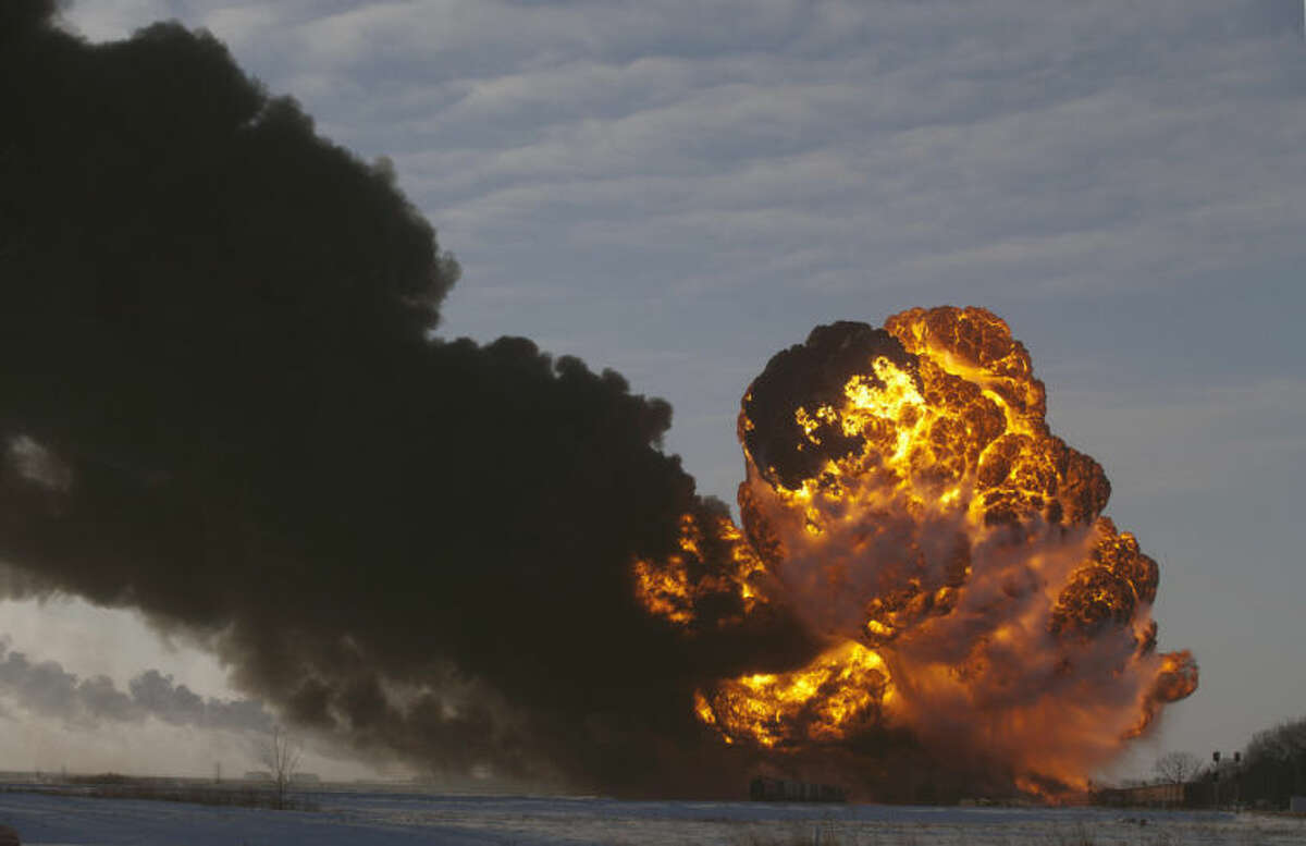 AP Photo/Bruce Crummy, File In this Dec. 30, 2013, file photo, a fireball goes up at the site of an oil train derailment in Casselton, N.D. Trains carrying millions of gallons of explosive liquids, including crude oil, are likely to continue rolling through major cities despite the government's urging to steer the shipments around population centers in the wake of several accidents, according to industry experts.