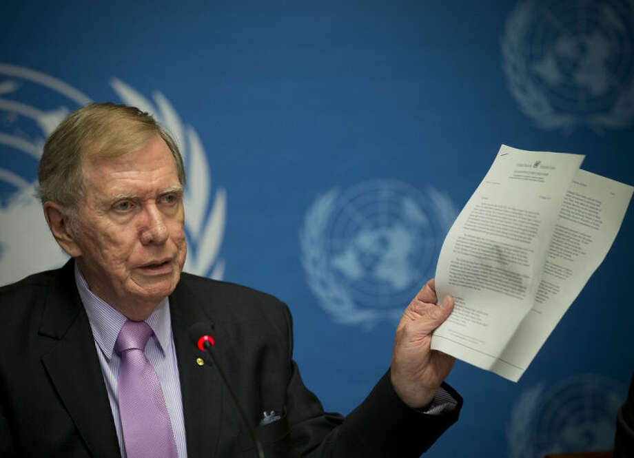 """Retired Australian judge Michael Kirby, chairperson of the commission of Inquiry on Human Rights in the Democratic People's Republic of Korea, shows a UN letter to North Korean leader warning on-accountability for 'crimes during a press conference at the United Nations in Geneva, Switzerland, Monday, Feb. 17, 2014. A U.N. panel has warned North Korean leader Kim Jong Un that he may be held accountable for orchestrating widespread crimes against civilians in the secretive Asian nation. Kirby told the leader in a letter accompanying a yearlong investigative report on North Korea that international prosecution is needed """"to render accountable all those, including possibly yourself, who may be responsible for crimes against humanity."""" (AP Photo/Anja Niedringhaus)"""