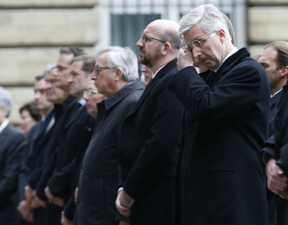 """Belgium's King Philippe, right, wipes his eyes as he stands next to Belgium's Prime Minister Charles Michel during a service in grounds of the Parliament building, in memory of the victims of the recent attacks in Belgium, Thursday, March, 24, 2016. Belgium's prime minister is promising to do everything to determine who was responsible for deadly attacks targeting the Brussels airport and subway system. Charles Michel, in a national mourning speech Thursday, said Tuesday's attacks on the European Union's capital targeted the """"liberty of daily life"""" and """"the liberty upon which the European project was built."""" (AP Photo/Alastair Grant)"""