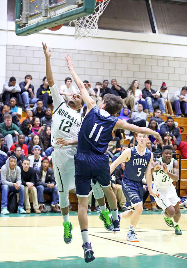 Norwalk's #12, Tommy Barrett, takes a shot during a home game against Staples Monday evening. Hour Photo / Danielle Calloway