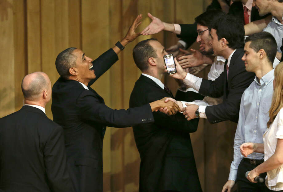 U. S. President Barack Obama shakes hands with attendees at a town hall meeting in Buenos Aires, Argentina, Wednesday, March 23, 2016. Obama is on a two day official visit to Argentina. (AP Photo/Natacha Pisarenko)