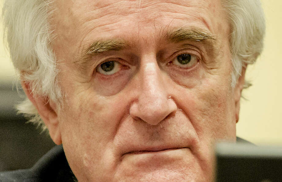 Bosnian Serb wartime leader Radovan Karadzic in the courtroom for the reading of his verdict at the International Criminal Tribunal for Former Yugoslavia (ICTY) in The Hague, The Netherlands Thursday March 24, 2016. The former Bosnian-Serbs leader is indicted for genocide, crimes against humanity, and war crimes. (Robin van Lonkhuijsen, Pool via AP)