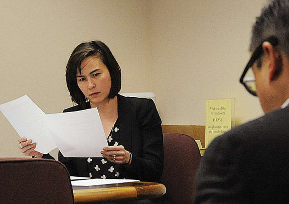 Maryli Secrest, secretary of the Wilton Democratic Town Committee, attends Tuesday night's caucus at Wilton Town Hall.