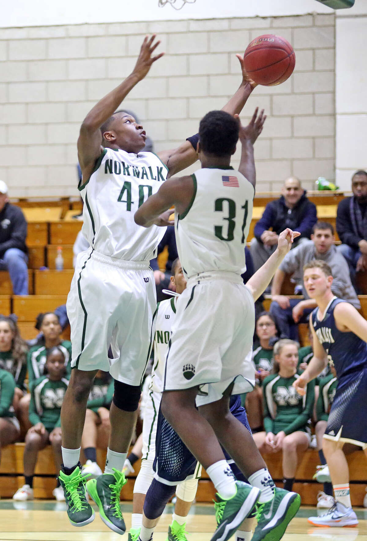 Norwalk's #40, Jakari Gainer, takes a shot during a home game against Staples Monday evening. Hour Photo / Danielle Calloway