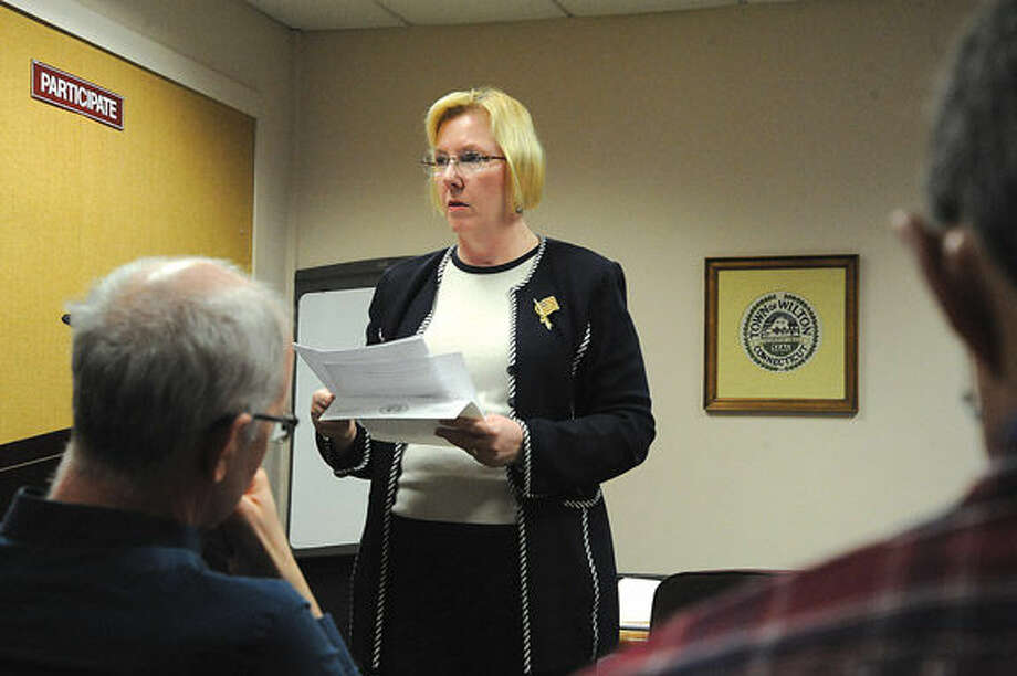 Deborah McFadden, chairman of the Wilton Democratic Town Committee, presides over the party's caucuses Tuesday night at Town Hall.