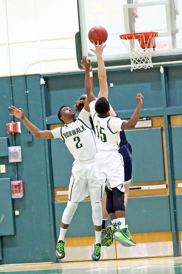 Norwalk's #2, Zaire Wilson, goes for the rebound during a home game against Staples Monday evening. Hour Photo / Danielle Calloway