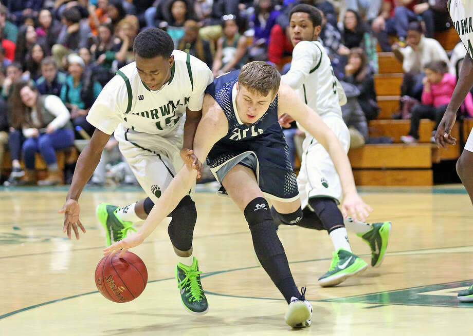 Staples #12, Sean Peitchett, dribbles the ball during an away game against Norwalk High School Monday evening. Hour Photo / Danielle Calloway