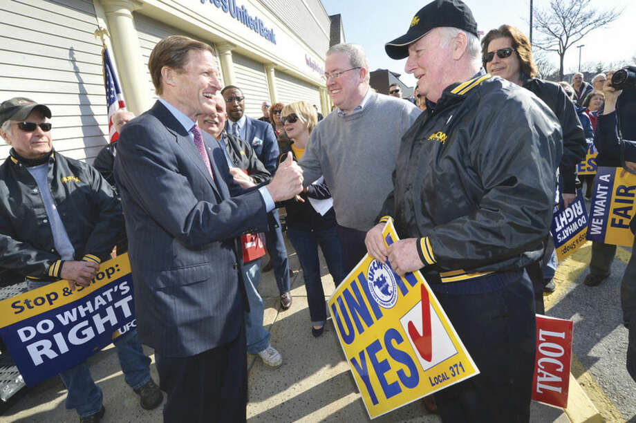 U.S. Sen. Richard Blumenthal fires up the crowd and talks with Thomas C. McCarthy and his father, Ed McCarthy, a 54-year veteran of Local 371 as a meat cutter, during a rally for better wages, benefits and respect for Stop & Shop workers at the Main Avenue Norwalk location.