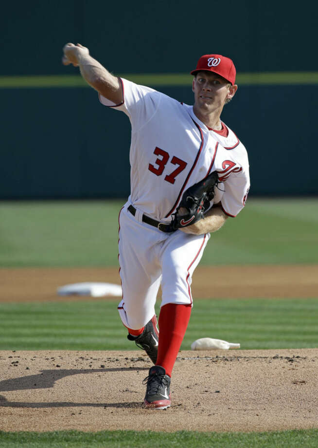 Washington Nationals starting pitcher Max Scherzer throws against the New York Yankees during the first inning of a spring training baseball game Wednesday, March 23, 2016, in Viera, Fla. (AP Photo/John Raoux)