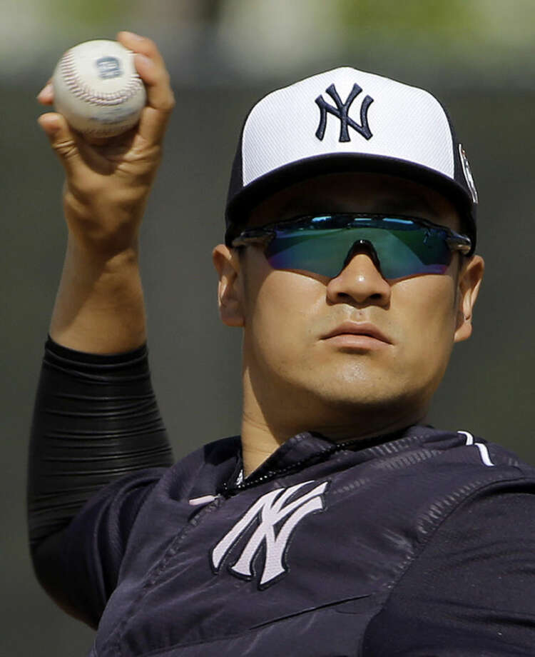 New York Yankees starting pitcher Masahiro Tanaka, of Japan, gets loose before a spring training baseball game against the Toronto Blue Jays Thursday, March 10, 2016, in Tampa, Fla. (AP Photo/Chris O'Meara)