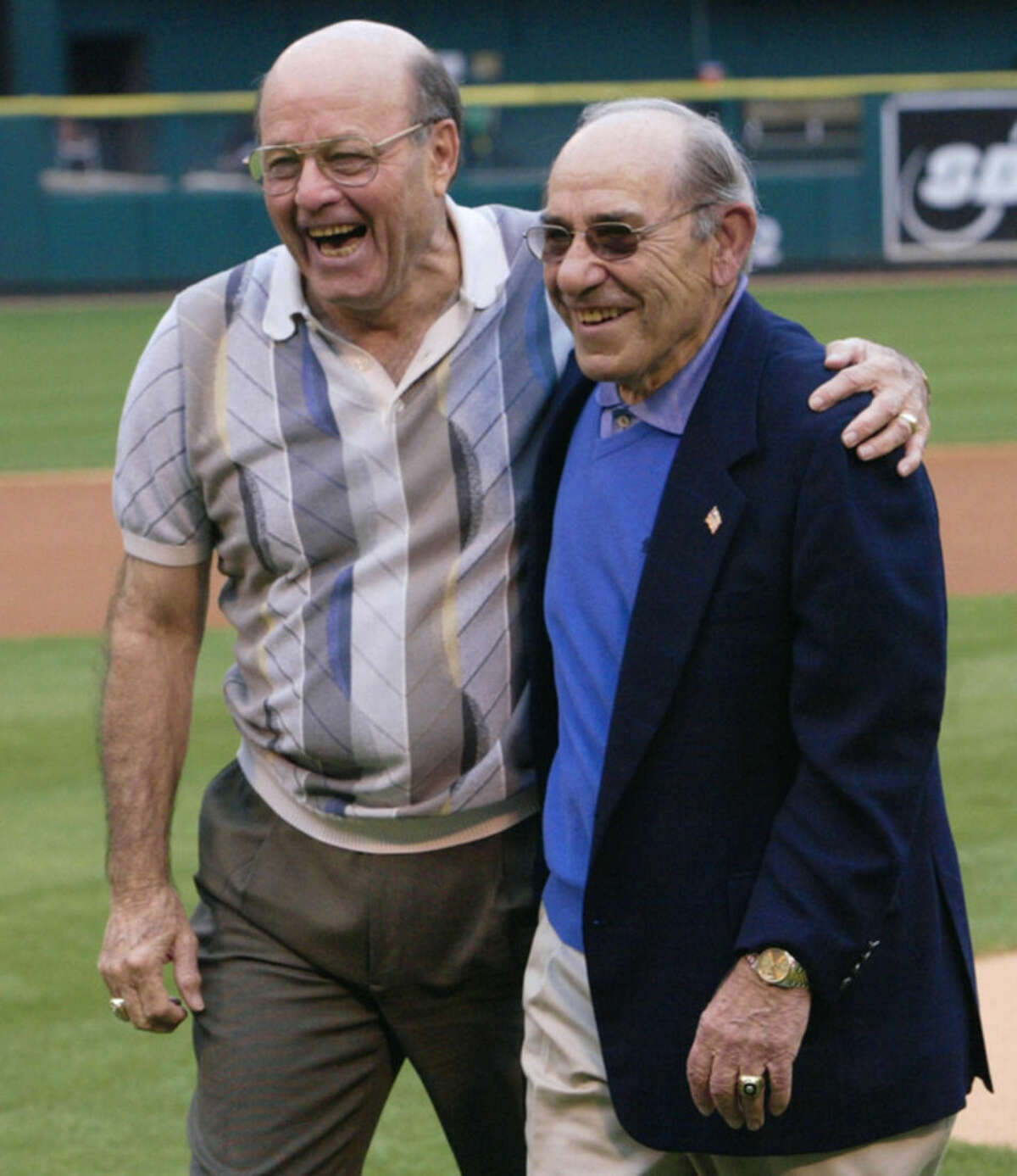 FILE - In this May 31, 2003, file photo, baseball Hall-of-Famers Joe Garagiola, left, and Yogi Berra share a moment after throwing out the first pitch before a game between the Pittsburgh Pirates and St. Louis Cardinals, in St. Louis. Former big league catcher and popular broadcaster Joe Garagiola has died. He was 90. The Arizona Diamondbacks say Garagiola died Wednesday, March 23, 2016. He had been in ill health in recent years.(AP Photo/Tom Gannam, File)