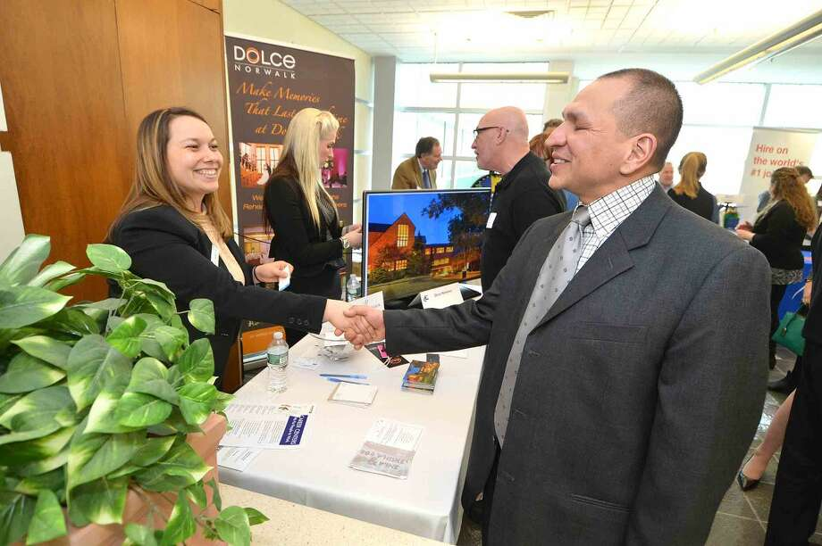Hour Photo/Alex von Kleydorff Jay Desiderio talks with Dolce Center's Krista Farrell at the Multi Chamber Expo at NCC