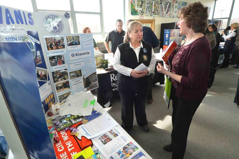 Hour Photo/Alex von Kleydorff Paula Conte with the Kiwanis Club of Norwalk speaks about the clubs programs with Nancy Pratt, Director of the Norwalk Mentor Program with the Human Services Council during the Multi Chamber Expo at NCC