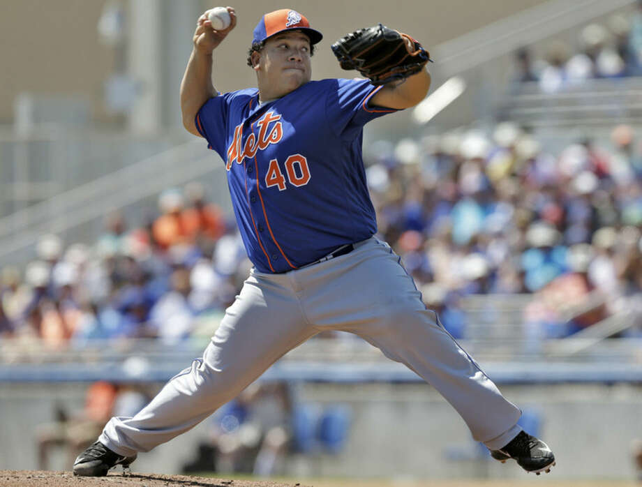 New York Mets starting pitcher Bartolo Colon delivers to the Toronto Blue Jays during the first inning of a spring training baseball game Wednesday, March 23, 2016, in Dunedin, Fla. (AP Photo/Chris O'Meara)