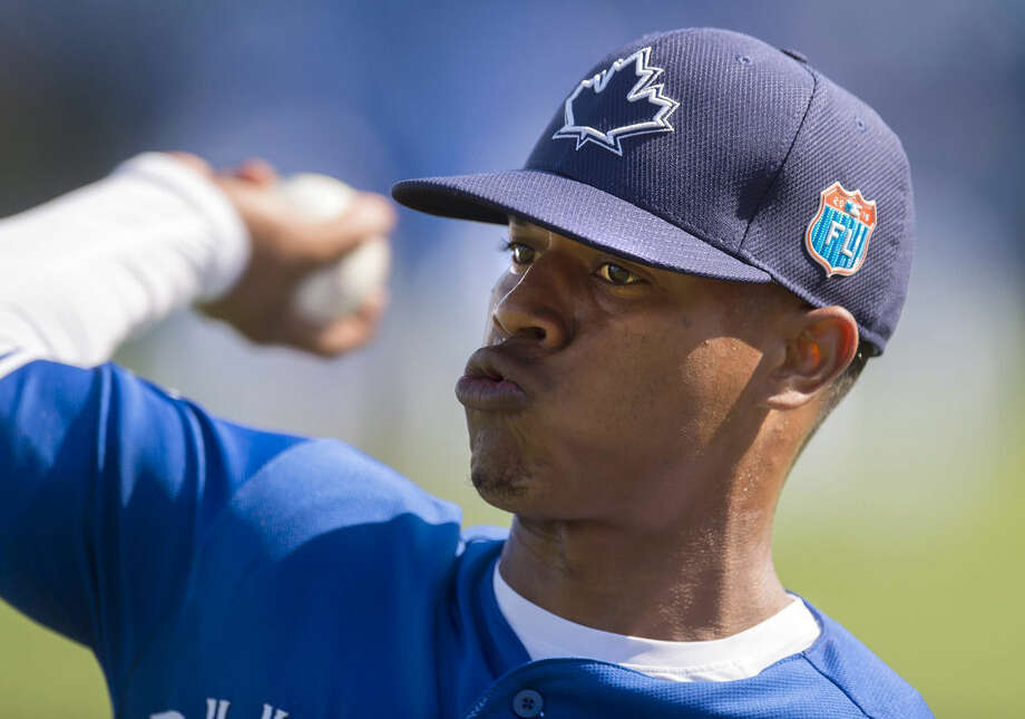 FILE - In this Feb. 29, 2016, file photo, Toronto Blue Jays pitcher Marcus Stroman warms up at spring training baseball practice in Dunedin, Fla. Stroman will be the Blue Jays' starter April 3, 2016, in the American League opener at Tampa Bay, manager John Gibbons announced Wednesday, march 23, 2016. (Frank Gunn/The Canadian Press via AP, File) MANDATORY CREDIT