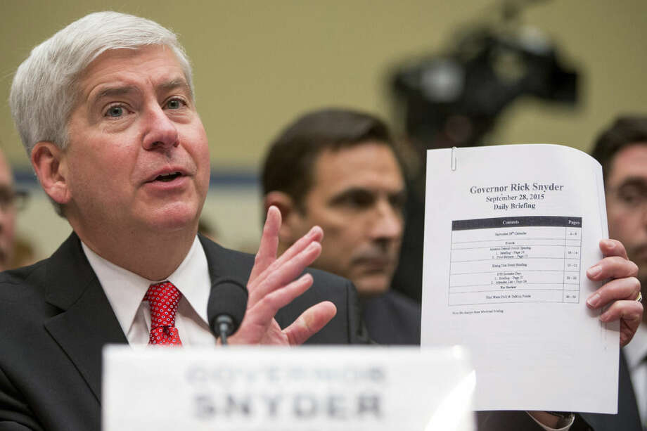 FILE - In this March 17, 2016, file photo, Michigan Gov. Rick Snyder testifies before a House Oversight and Government Reform Committee hearing in Washington, Thursday, March 17, 2016, to look into the circumstances surrounding high levels of lead found in many residents' tap water in Flint, Mich. t's been two years since problems began with the drinking water in Flint, Michigan, and nearly six months since officials declared a public health emergency. Yet a bipartisan congressional effort to aid the predominantly African-American city is idling in the Senate. (AP Photo/Andrew Harnik, File)