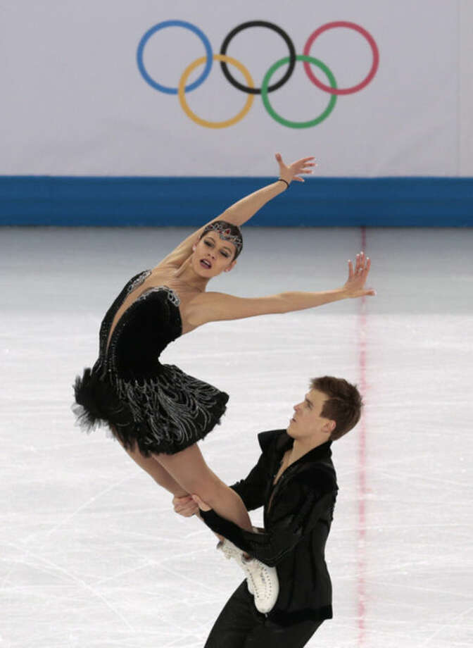 Elena Ilinykh and Nikita Katsalapov of Russia compete in the ice dance free dance figure skating finals at the Iceberg Skating Palace during the 2014 Winter Olympics, Monday, Feb. 17, 2014, in Sochi, Russia. (AP Photo/Ivan Sekretarev)