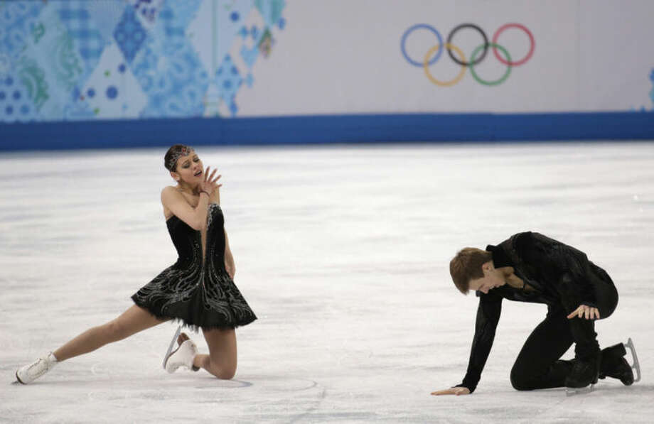 Elena Ilinykh and Nikita Katsalapov of Russia react after completing their routine in the ice dance free dance figure skating finals at the Iceberg Skating Palace during the 2014 Winter Olympics, Monday, Feb. 17, 2014, in Sochi, Russia. (AP Photo/Bernat Armangue)