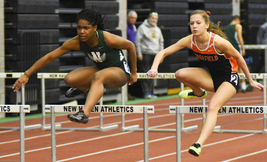 Hour photo/John Nash - Action from the Class LL Track Championship meet.