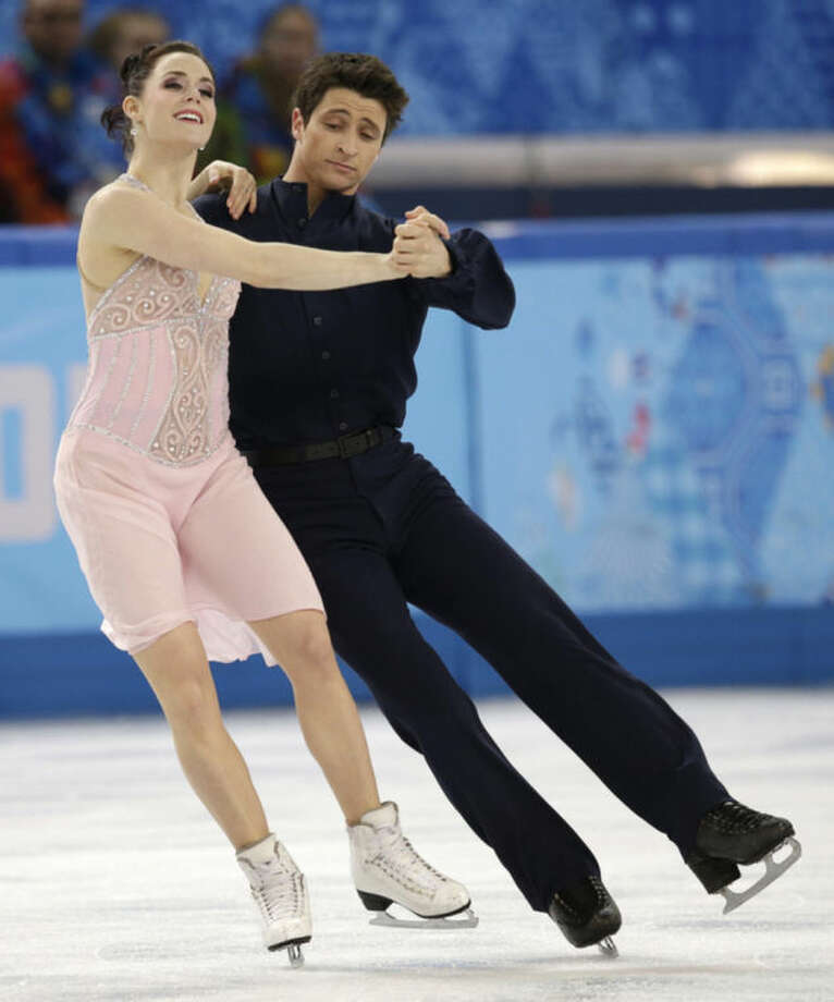 Tessa Virtue and Scott Moir of Canada compete in the ice dance free dance figure skating finals at the Iceberg Skating Palace during the 2014 Winter Olympics, Monday, Feb. 17, 2014, in Sochi, Russia. (AP Photo/Darron Cummings)