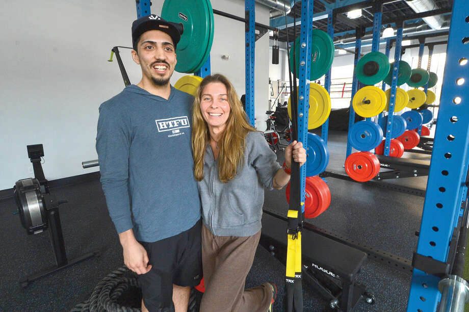 Hour Photo/Alex von Kleydorff Next Generation Fitness Co-Owners Jennifer Mongeluzo and Bruce Ceja next to the weight rig in their West Ave Gym