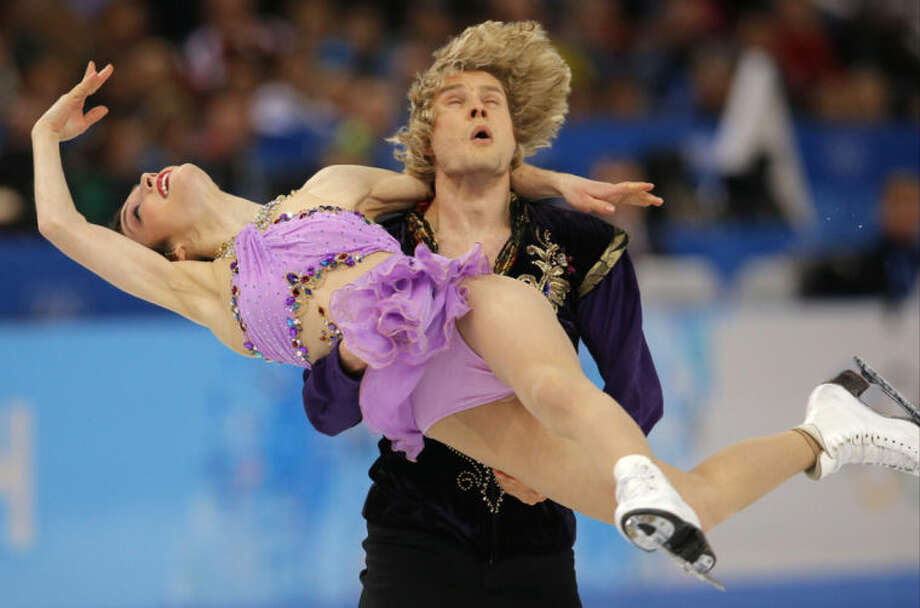 Meryl Davis and Charlie White of the United States compete in the ice dance free dance figure skating finals at the Iceberg Skating Palace during the 2014 Winter Olympics, Monday, Feb. 17, 2014, in Sochi, Russia. (AP Photo/Vadim Ghirda)