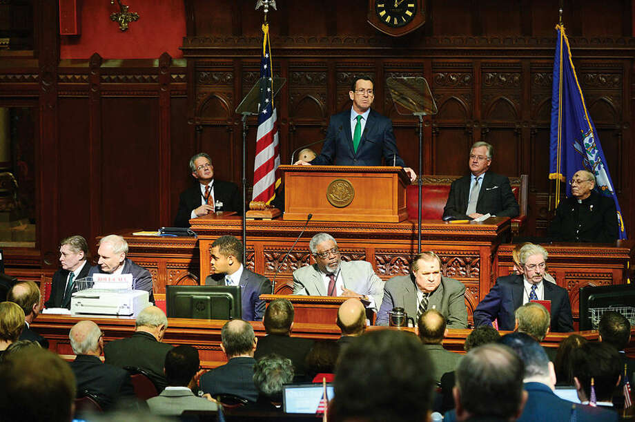 Hour photo / Erik Trautmann Connecicut Governor Dannel Malloy gives his budget address to the joint legislative session Wednesday at the state capitol in Hartford.
