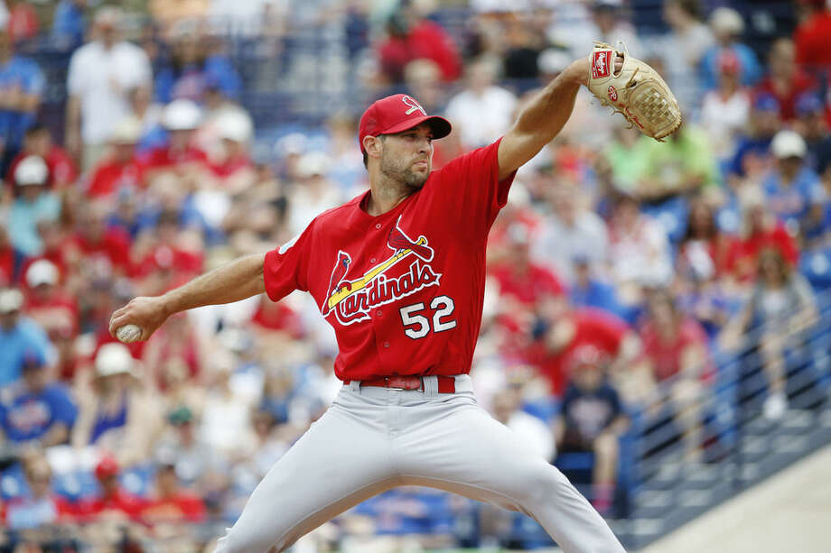 St. Louis Cardinals' starting pitcher Michael Wacha throws during the first inning of an exhibition spring training baseball game against the New York Mets, Friday, March 25, 2016, in Port St. Lucie, Fla. (AP Photo/Brynn Anderson)